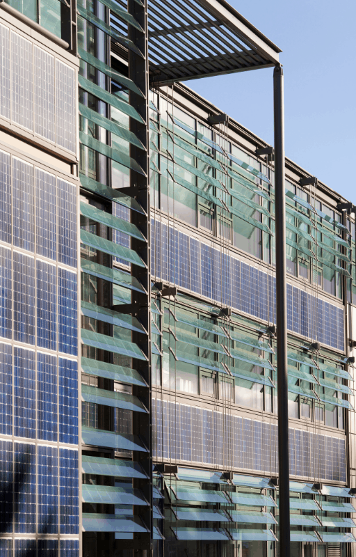 solar panels on the side of a large office building
